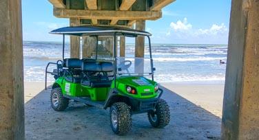 Golf cart rentals Port Aransas. Golf cart under the pier.