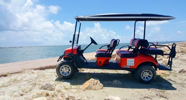 One of our Port Aransas Golf Cart Rentals at the Jetty.